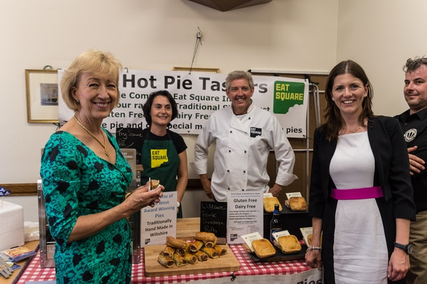 Michelle doneland mp with andrea ledson mp in westminster sampling eat square pies