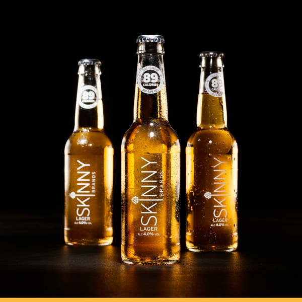3 skinny lager bottles black background  1